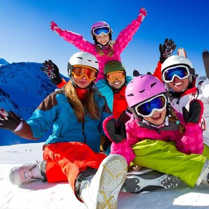 Skiing, panorama - family enjoying winter vacation